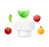 organic food around a white chefs hat Stock Images