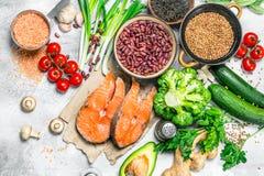 Organic food. Assortment of heathy food with raw salmon steaks