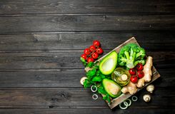 Organic food. Assortment of ripe vegetables in a wooden box stock photos