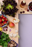 Organic food background. Fresh vegetables and fruits on wooden store shelves. Top view, copy space. Stock Images