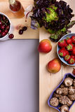 Organic food background. Fresh vegetables and fruits on wooden store shelves. Top view, copy space. Royalty Free Stock Images