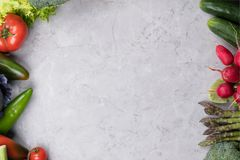 Organic food background. Food photography different vegetable on gray marble background. Copy space. High resolution product royalty free stock photography