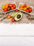 Organic food background. Studio photo of different fruits and vegetables on white wooden table. High resolution product. royalty free stock image