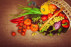 Organic food background vegetables and fruits in the basket. Top. View. Copy space below. Warm toned. Horizontal Royalty Free Stock Photography