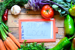 Organic food with buy local concept. Stock Photos