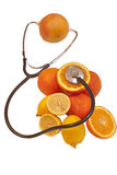 Organic food concept. With fruits and stethoscope Stock Photo