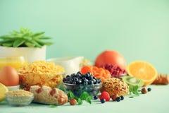 Organic food frame. Banner. Healthy breakfast ingredients. Oat and corn flakes, eggs, nuts, fruits, berries, toast, milk, yogurt, royalty free stock image