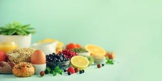 Organic food frame. Banner. Healthy breakfast ingredients. Oat and corn flakes, eggs, nuts, fruits, berries, toast, milk, yogurt, royalty free stock photography