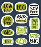Organic food hand drawn labels set. Vector illustration. Vegetarian, gmo free, fresh and natural, vegan, soy free, healthy diet, lifestyle, low fat food Stock Images