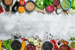 Organic food. Healthy assortment of vegetables and fruits with legumes. On a rustic background stock photo