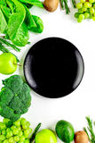 Organic food for homemade salad with green vegetables and plate white desk background top view mock-up Stock Photos