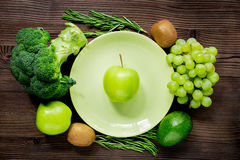 Organic food for homemade salad with green vegetables on wooden desk background top view. Organic food for homemade salad with green vegetables on wooden kitchen Royalty Free Stock Photo