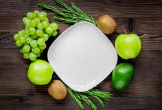 Organic food for homemade salad with green vegetables on wooden desk background top view mock-up. Organic food for homemade salad with green vegetables on wooden Royalty Free Stock Photo