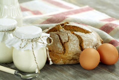 Organic food. Homemade yogurt, milk, bread and egg Stock Photography