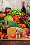 Organic food including vegetables fruit bread dairy and meat. Variety of organic food including vegetables fruit bread dairy and meat. Balanced diet Stock Photos