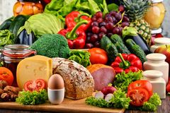 Organic food including vegetables fruit bread dairy and meat. Variety of organic food including vegetables fruit bread dairy and meat. Balanced diet Stock Photography