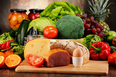 Organic food including vegetables fruit bread dairy and meat. Variety of organic food including vegetables fruit bread dairy and meat. Balanced diet Stock Photo