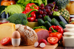 Organic food including vegetables fruit bread dairy and meat. Variety of organic food including vegetables fruit bread dairy and meat. Balanced diet Royalty Free Stock Photography