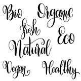 Organic food labels with hand drawn lettering. Healthy stickers. Design for print. Vector illustration Royalty Free Stock Images