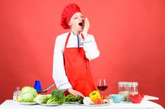 Organic food. professional chef on red background. sleepy woman cooking healthy food by recipe. restaurant menu. Dieting. Organic eating and vegetarian stock photo