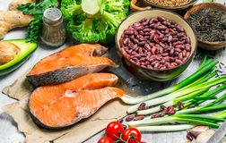 Organic food. Raw salmon fish with healthy food. On a rustic background stock image