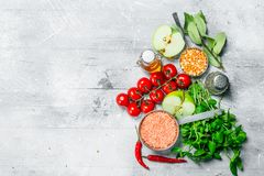 Organic food. Ripe vegetables with legumes. On a rustic background royalty free stock photo