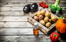Organic food. Ripe vegetables. On a wooden background royalty free stock photo
