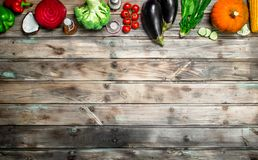 Organic food. Ripe vegetables. On a wooden background royalty free stock image