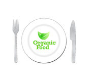 Organic food sign on a white plate. Stock Image