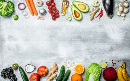 Organic food. Variety of healthy vegetables and fruits. On a rustic background stock photography