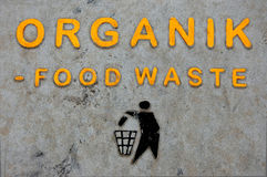 Organic food waste inscription. On gray background Royalty Free Stock Image