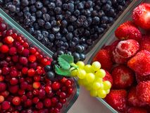 Organic fresh berry and grape background. Healthy eating concept. top view stock image