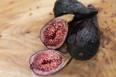 Organic fresh half cut purple sweet fig fruit royalty free stock photos