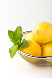 Organic, fresh mint leaves and lemons in a strainer Stock Photography