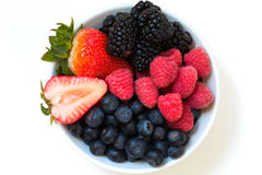 Organic fresh mixed berries fruit in a bowl on the table. Close up Stock Images