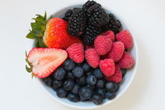Organic fresh mixed fruit in a bowl on the table. royalty free stock images