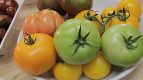 Organic fresh tomatoes. Close up of fresh organic tomatoes. Handheld shot stock footage