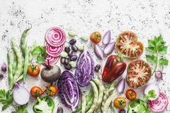 Organic fresh vegetables background. Cabbage, beets, beans, tomatoes, peppers on a light background, top view. Flat lay Royalty Free Stock Image