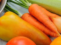 Organic fresh vegetables, ingredients for preparing food on linen tablecloth. Royalty Free Stock Image