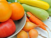 Organic fresh vegetables for preparing food on linen tablecloth, vintage wooden background. Stock Image