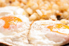 Organic fried eggs with hashbrowns Stock Photo