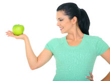 Organic Fruit. Diet concept. a woman holding green apple on her right hand. isolated on white stock photography
