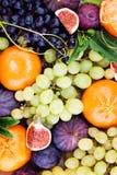 Organic Fruit Background. Green Grape, Plum, Tangerines Stock Images