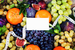 Organic Fruit Background with White Measuring Tape Stock Photos