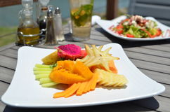 Organic Fruit Plate / Garden Salad - Vegetables / Fruits. Organic Fruit Plate with Mango, Pineapple, Carambola, and Dragon Fruit - Garden salad with lettuce Stock Photo