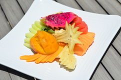 Organic Fruit Plate - Vegetables / Fruits. Organic Fruit Plate with Mango, Pineapple, Carambola, and Dragon Fruit Stock Images