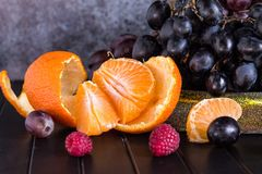 Raw Organic Fruit Platter with Berries Melons and Grapes stock images