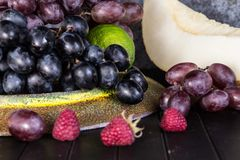 Raw Organic Fruit Platter with Berries Melons and Grapes royalty free stock photo