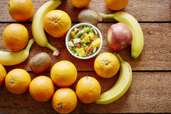 Organic fruit salad surrounded by variery of fruits. 