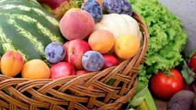 Organic fruit and vegetable - healthy eating, healthy food. Organic fruit, healthy eating, healthy food in wicker-basket Royalty Free Stock Photo